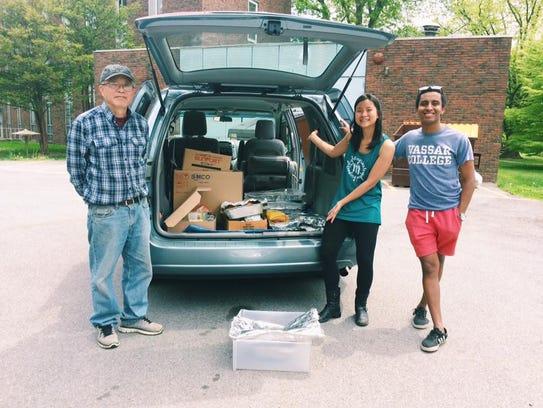 Rescuing Leftover Cuisine volunteers distribute food