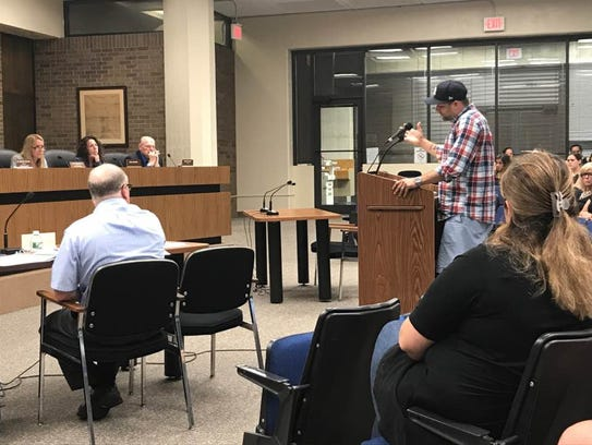 Chris Mania urges members of the Woodland Park Board