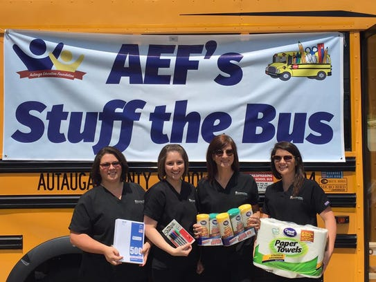 Community members donate school supplies during the