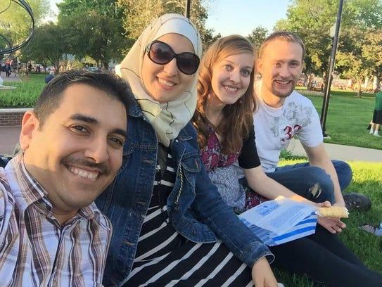 Mohammed Alobaidi, left, his wife Larsa Albayati, and