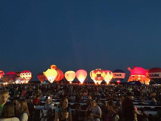 Balloons glow during the 2017 Balloon & Rib Fest in