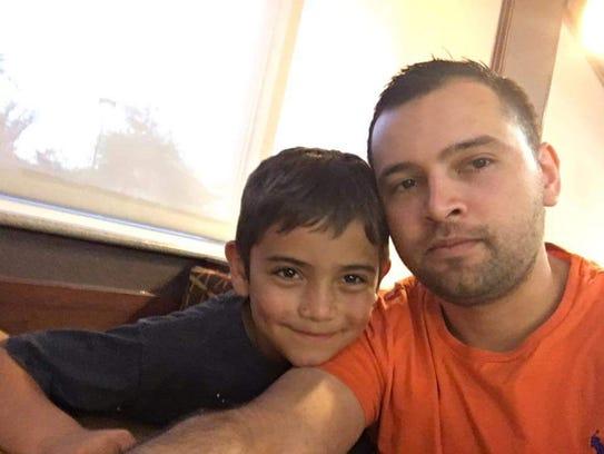 Acis Raiden Garcia, 8, and his father Julio Garcia