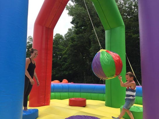 """Thomas Mayfield, 6, plays with an inflatable """"wrecking"""