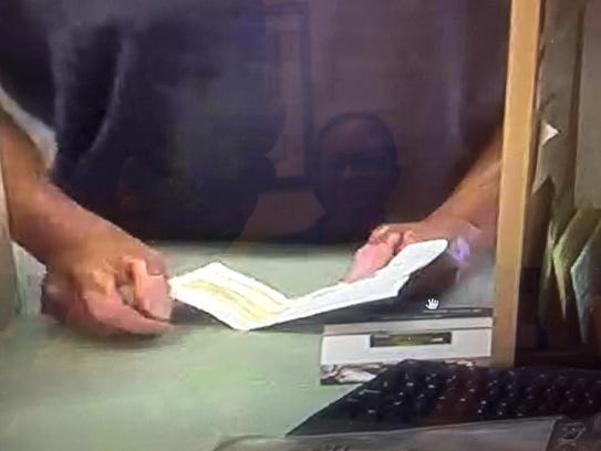 The hands of the robber at the PNC Bank shows either
