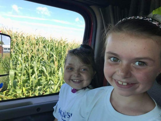 Reese Burdette, left, and her sister, Brinkley, get