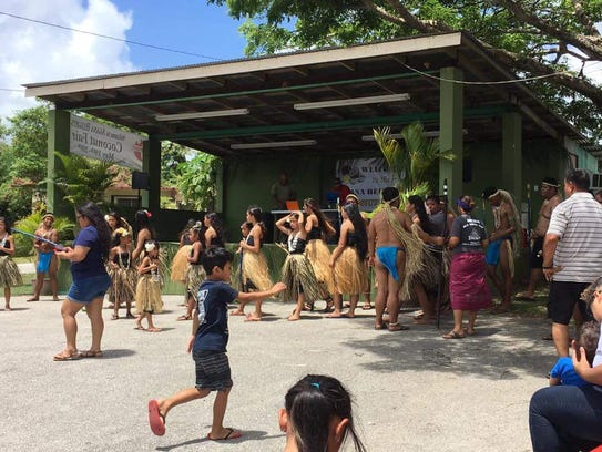 Guam residents at the Annual Coconut Fair in Agana