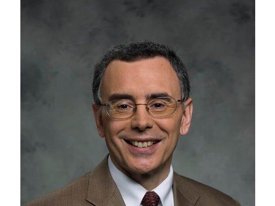 Dr. Brent Egan