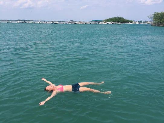 Laurie K. Blandford floats freely at the Stuart Sandbar.