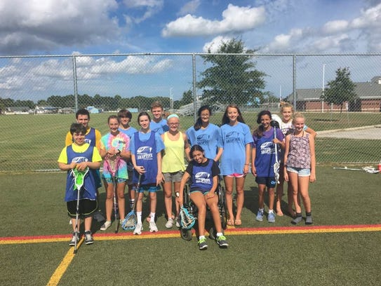 Members of the Atlantic Adaptive Lacrosse program pose