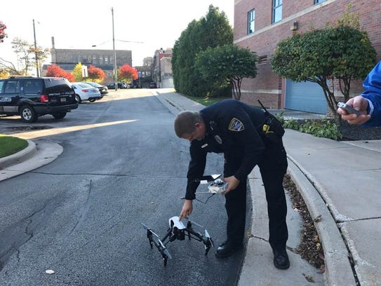 Officer Rick Ladwig sets up the drone for a demonstration