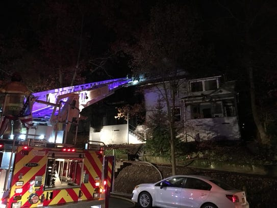 Firefighters extinguished a fire at a home at 120 Hudson