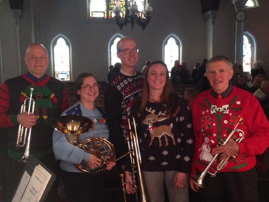 From left to right, in holiday sweaters; Eric Hummel,