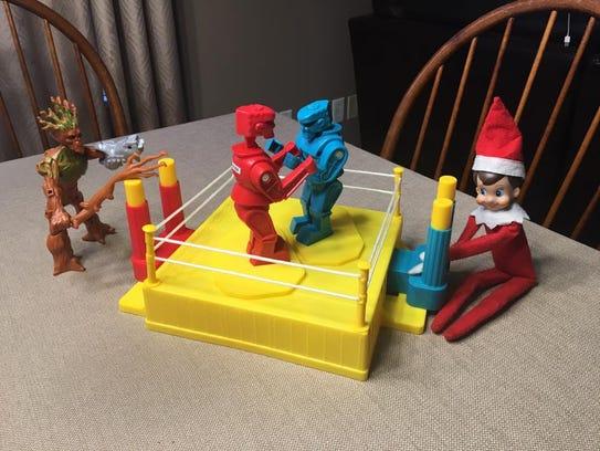 Elf on the Shelf playing Rock 'Em Sock 'Em Robots.