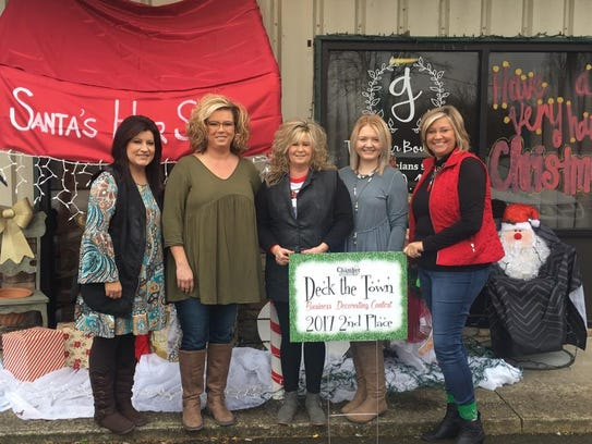 """Portland Chamber of Commerce executive director Sherri Ferguson, right, presented Southern Charm Salon and Boutique with second place in the """"Deck the Town"""" business decorating contest."""