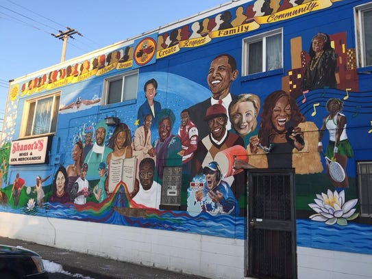 This mural at West Saginaw and Baker streets is displayed on a building where a former beauty supply store was located. It honors several black leaders and others of notable stature.