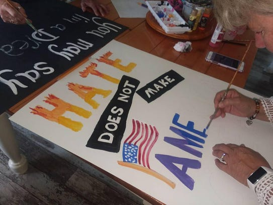 A participant makes a sign for the Brevard Women's March 2018.