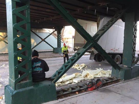 A big truck gets stuck on Main Street in Brockport,