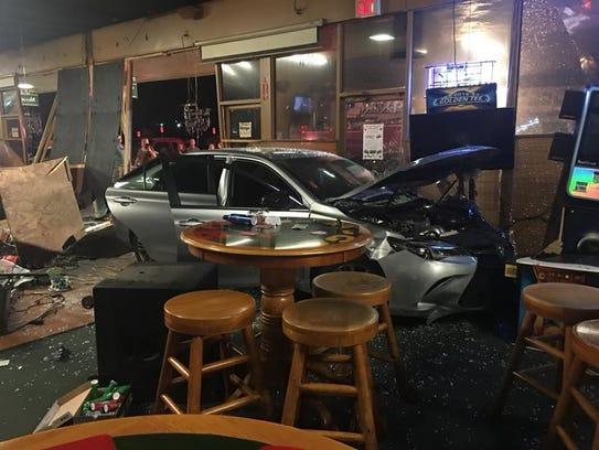A car drove through the front window of Mug's Pub on