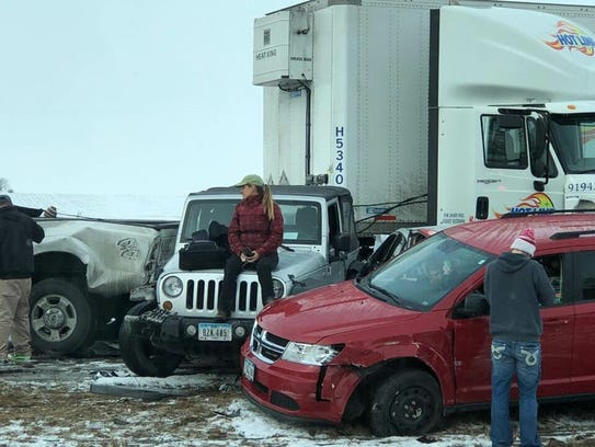 Drivers survey the aftermath of a multiple-vehicle