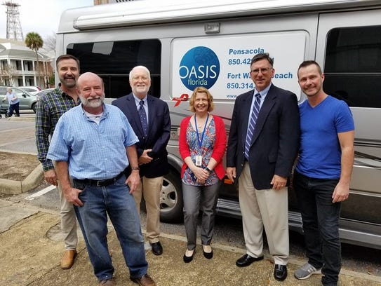 From left, William Bedwell, executive director OASIS