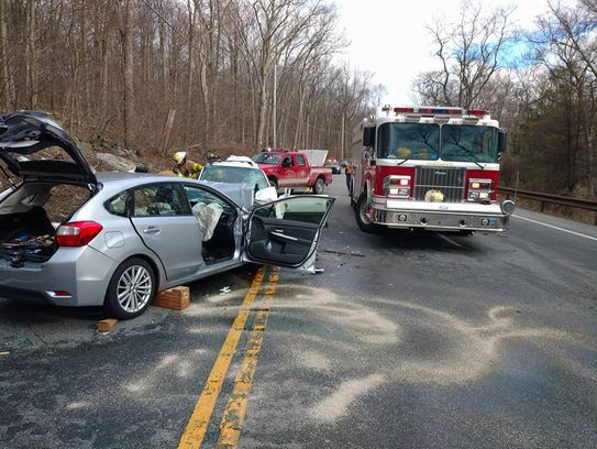 Three people were injured in a head-on crash on Route