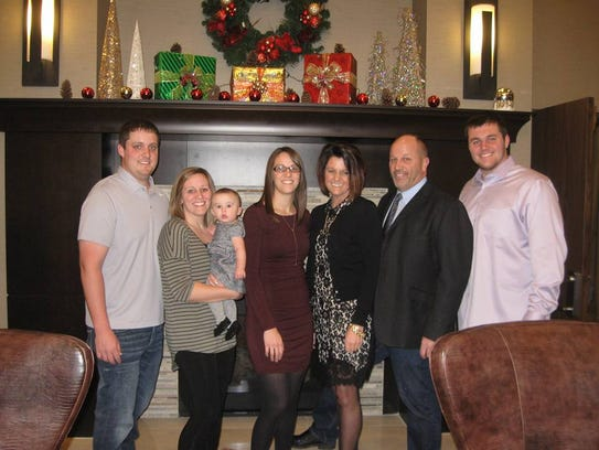 The Banwart family poses for a Christmas photo last