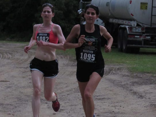 Sheryl Rosen (left) finished a few hairs ahead of Katie Sherron. It was so close that both runners were clocked in 28:47.