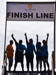 Members of Team Inspira celebrate at the finish line