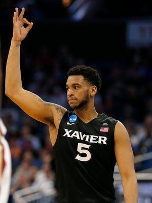 Xavier Musketeers guard Trevon Bluiett (5) holds up 3 after scoring in the first half of the NCAA Tournament Second Round game between the Florida State Seminoles and the Xavier Musketeers at the Amway Center in Orlando, Fla., on Saturday, March 18, 2017.