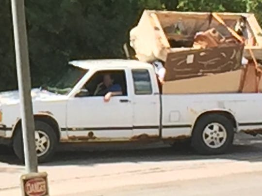 Garbage packed  precariously on a truck heading to dump site.