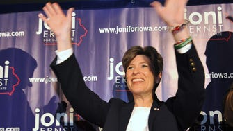 Joni Ernst, Republican candidate for Senate in Iowa, waves to supporters on Oct. 30 in Ames, Iowa.