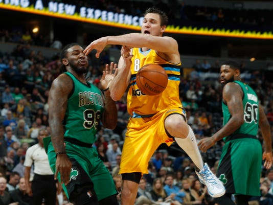 Denver Nuggets forward Danilo Gallinari (8), of Italy, is fouled as he drives the lane by Boston Celtics forward Jae Crowder in the first half of an NBA basketball game Friday, March 10, 2017, in Denver. (AP Photo/David Zalubowski)