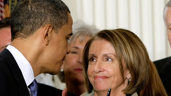 AP Pelosi Checking Obama_003