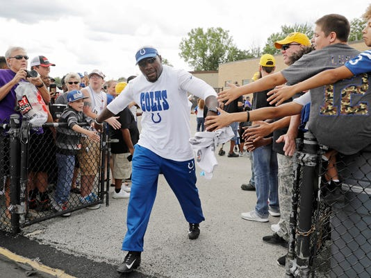 FILE - In this Aug. 5, 2017, file photo, former Indianapolis Colts player and current assistant coach Robert Mathis greets fans as he walks out to a practice during the NFL football team's training camp in Indianapolis. Mathis was jailed Tuesday, Oct. 24, 2017, on a preliminary charge of driving while intoxicated. Police in the Indianapolis suburb of Carmel say Mathis was arrested on the misdemeanor charge early Tuesday after driving the wrong way on a one-way street and not signaling a turn. (AP Photo/Darron Cummings, File)