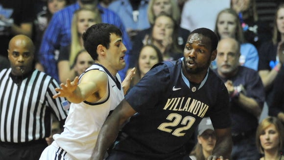 Butler's Alex Barlow defends against Villanova's Jayvaughn Pinkston  in the first half as the butler bulldogs hosted the Villanova Wildcats in Butler's Big East basketball debut at Hinkle Fieldhouse Tuesday December 31, 2013.