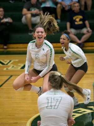Noelle Tursky and her Fort Myers teammates celebrate a point against Estero in the District 7A-11 volleyball championship at Fort Myers High School on Thursday, October 19, 2017.