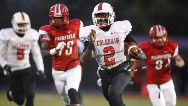 Colerain quarterback Deshaunte Jones sprints upfield on a big gain in the first quarter during the high school football game between the Colerain Cardinals and the Fairfield Indians, Friday, Oct. 2, 2015, at Fairfield Stadium in Fairfield, Ohio.