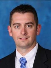 New Castle football coach Kyle York.