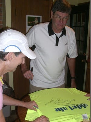 Jim Ryun signs Madeira Mile T-shirts in preparation for the race.