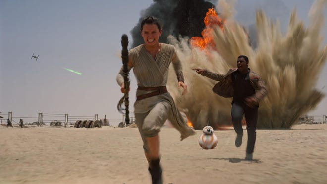 """Daisey Ridley stars as Rey, and John Boyega as Finn, in the new film """"Star Wars: The Force Awakens."""""""