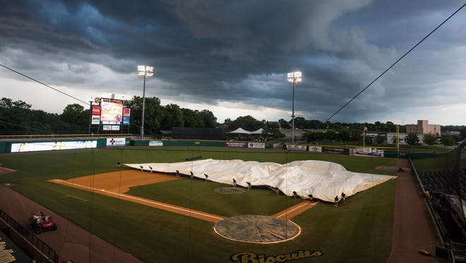 The field is tarped before the Montgomery Biscuits game at Riverwalk Stadium in Montgomery, Ala. on Friday June 23, 2017.