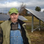 Solar panels collect the sun's energy on Milton farmer William Werba's property on Old Indian Road in the Town of Marlborough on Dec. 15, 2015.