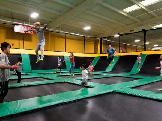 Kids of all ages have fun at Rockin' Jump trampoline park on September 30, 2017.