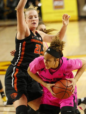 Arizona State forward Kianna Ibis (42) maneuvers against Oregon State center Marie Gulich (21) during a PAC-12 game at Wells Fargo Arena in Tempe, Ariz. February 25, 2018.