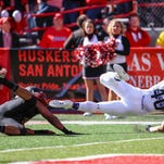 Northwestern running back Dan Vitale reaches the end zone after breaking a tackle by Nebraska linebacker Dedrick Young on Saturday.