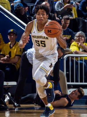 Michigan guard Eli Brooks (55) dribbles the ball in the second half of an NCAA college basketball game against UC Riverside at Crisler Center in Ann Arbor, Mich., Sunday, Nov. 26, 2017. The Spring Grove grad scored a career-high eight points and added a career-high four rebounds in Michigan's 87-42 win.