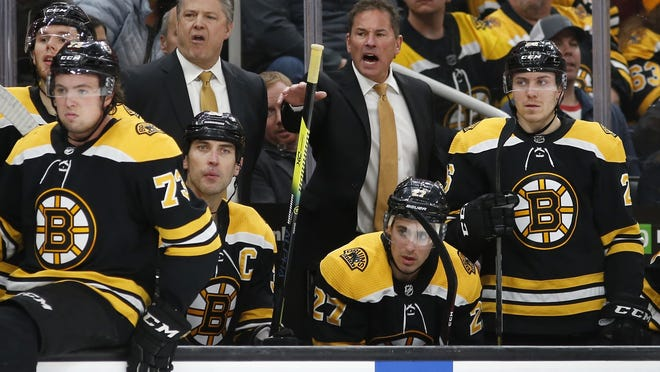 Bruins head coach Bruce Cassidy, center, has seen his share of unique training camp experiences.