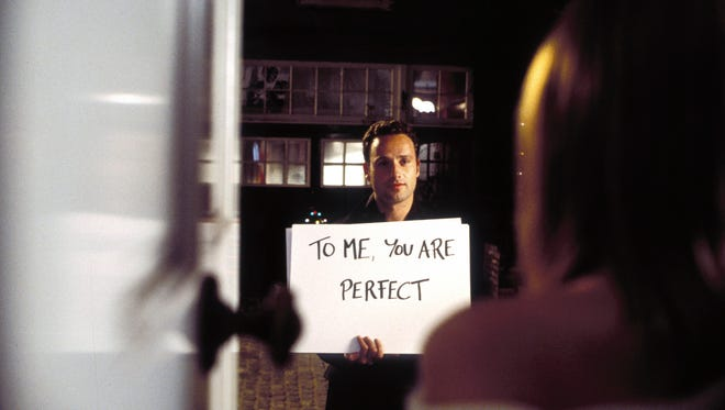 Andrew Lincoln holds the cards in 'Love Actually.'