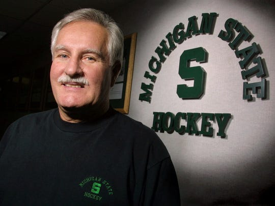 Michigan State hockey coach Ron Mason poses for a photo March 7, 2001, in East Lansing.