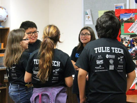 Members of Tulie Tech, from Tularosa, huddle together to brainstorm an answer after the judges asked them what makes their team unique.
